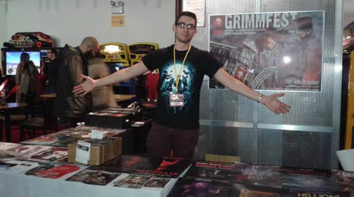 Courtney selling posters at the Grimmfest Festvial Hub